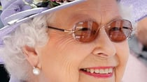 Queen Elizabeth was snapped on Derby Day at Epsom Racecourse on June 2 wearing glasses with tinted lenses, and of course a broad smile. Source: Getty