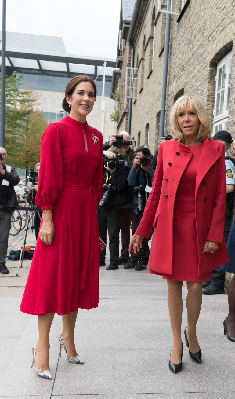 Princess Mary and French First Lady Brigitte Macron both looked glamorous in red in Copenhagen.