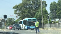Police direct traffic as a power outage cut the traffic lights. Source: Pamela Cole