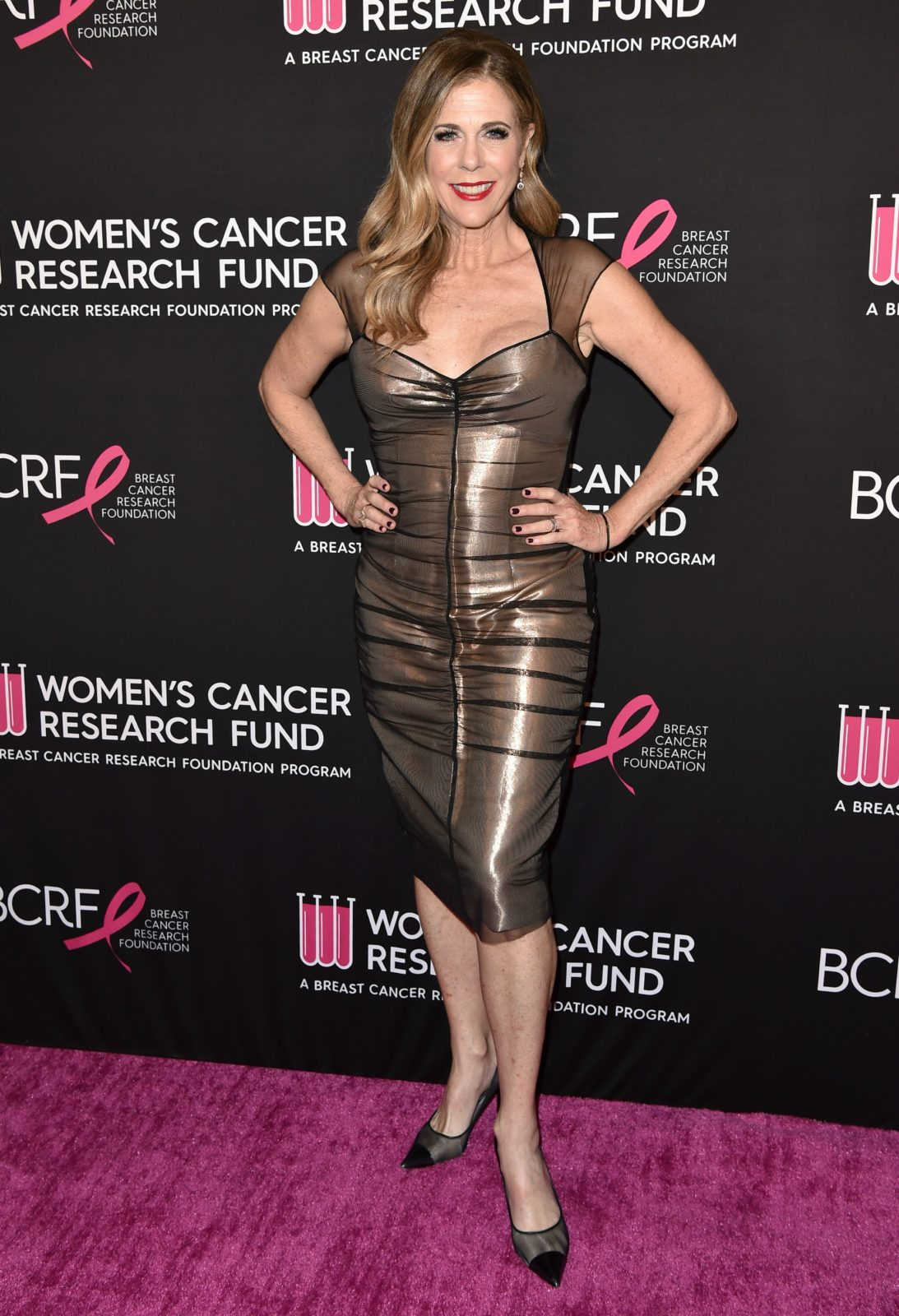 Rita Wilson put on a striking display in a fitted metallic dress. Source: Getty