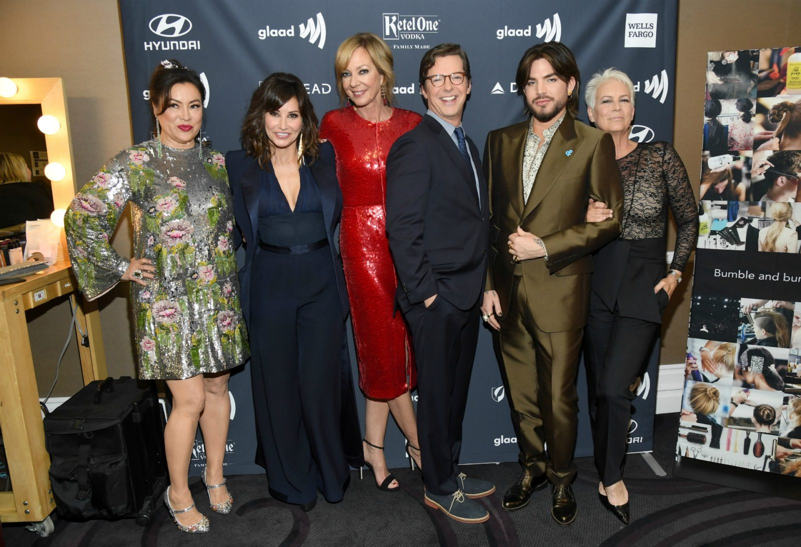 Jennifer Tilly, Gina Gershon, Allison Janney, Sean Hayes, Adam Lambert, and Jamie Lee Curtis pose together.