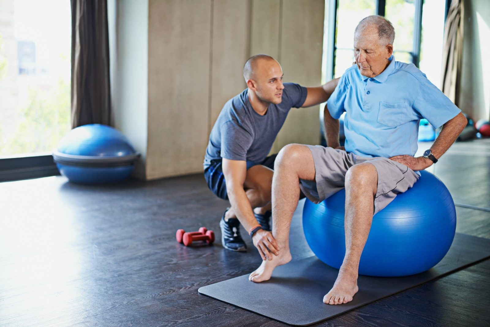 Sitting on a ball with your feet on the floor and your back straight while bouncing is a great weight-bearing exercise.