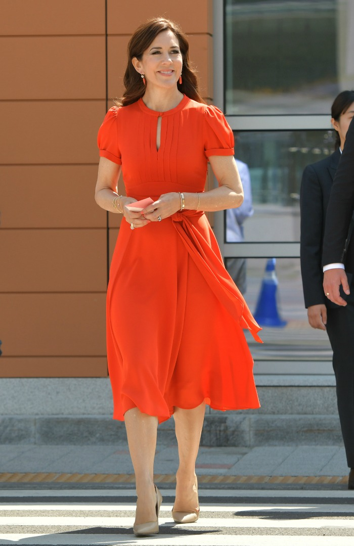 The crown princess looked incredible as she stepped out in orange in Seoul. Source: Getty.