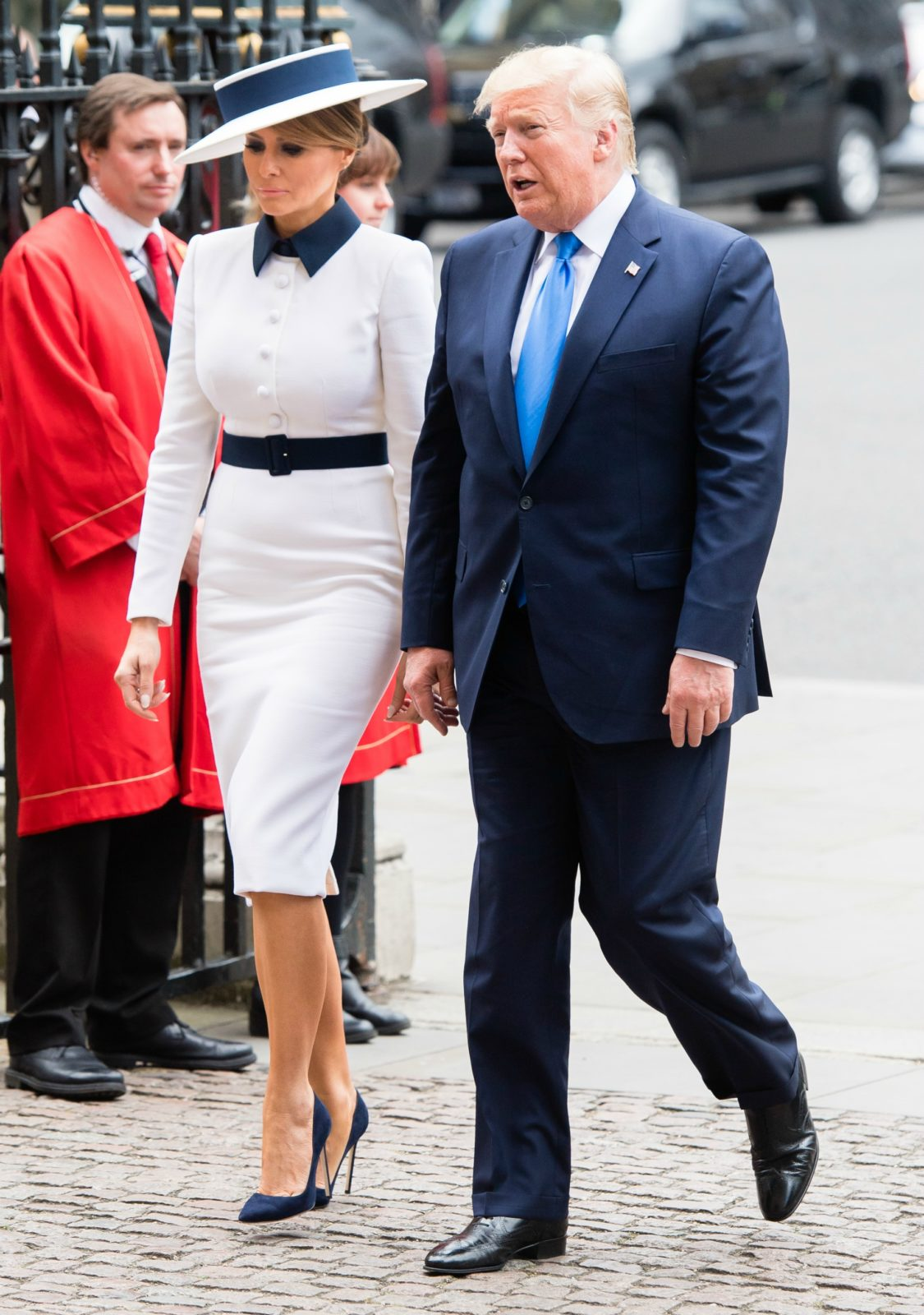 Melania has channeled the late Princess Diana in a retro white ensemble as she arrived at Buckingham Palace on Monday afternoon alongside her husband Donald Trump. Source: Getty