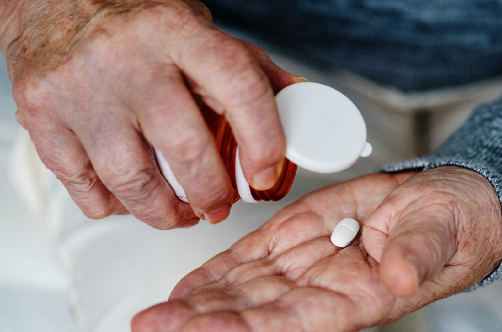 man using medication to treat incontinence