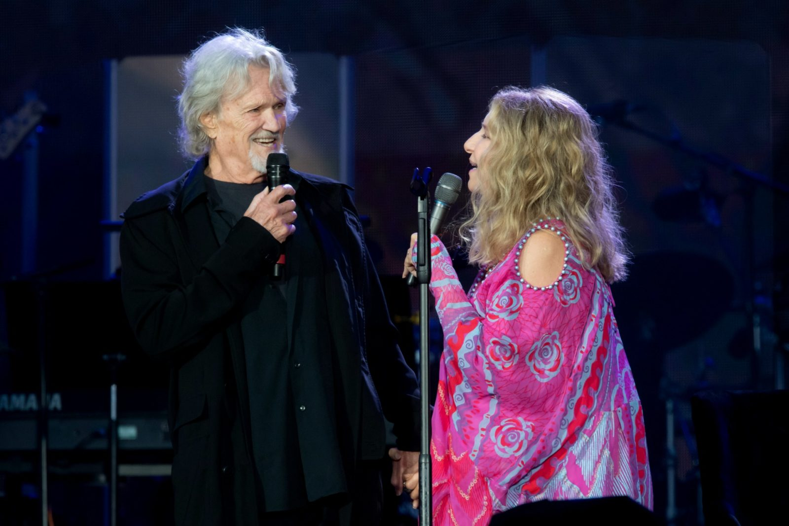 Barbra Streisand performs with Kris Kristofferson at Hyde Park in London.