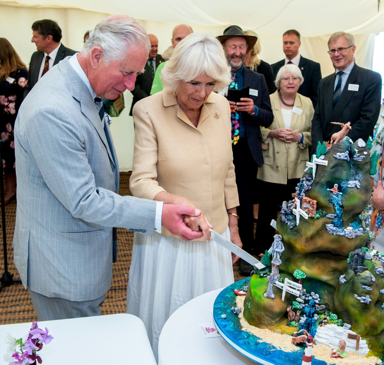 Charles and Camilla even cut the cake together. Source: Getty.
