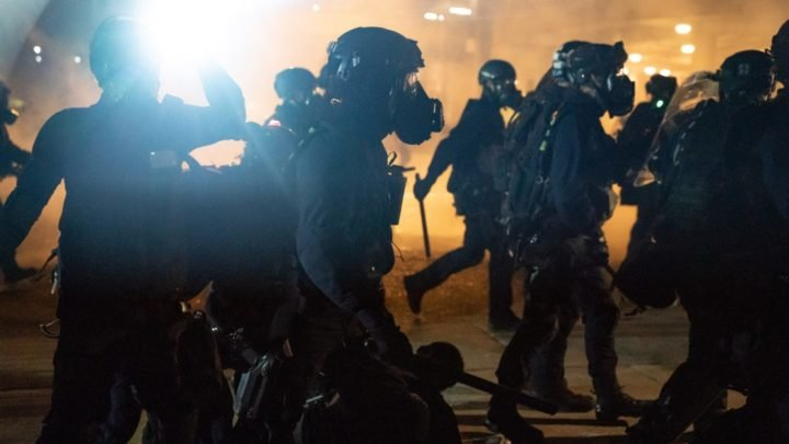 Riot police charge toward protesters during the current unrest in Hong Kong. Source: Getty Images