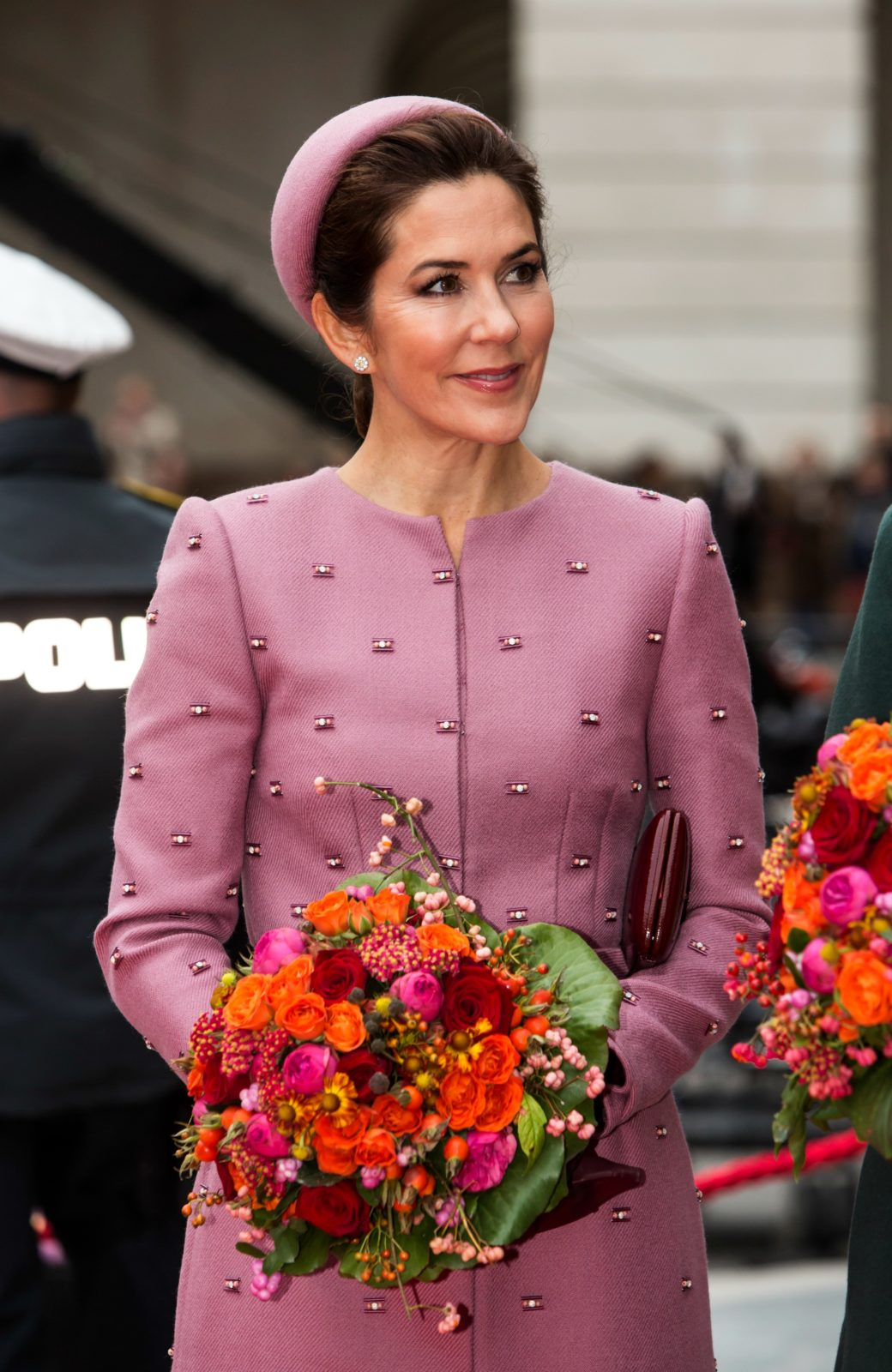 Princess Mary stood out in the dusty pink coat dress and pillbox hat to open Parliament. Source: Getty.