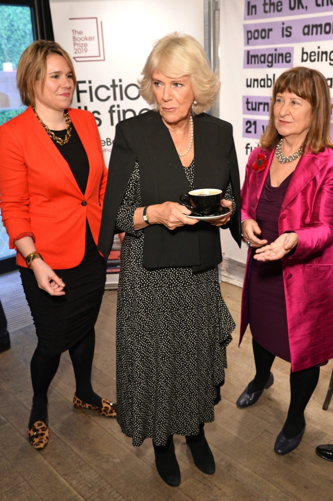 Camilla debuted a modern cape-style jacket over her traditional polka dot dress. Source: Getty.