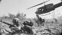 US troopers get down low after being dropped by helicopter into landing under enemy fire. Source: Getty Images