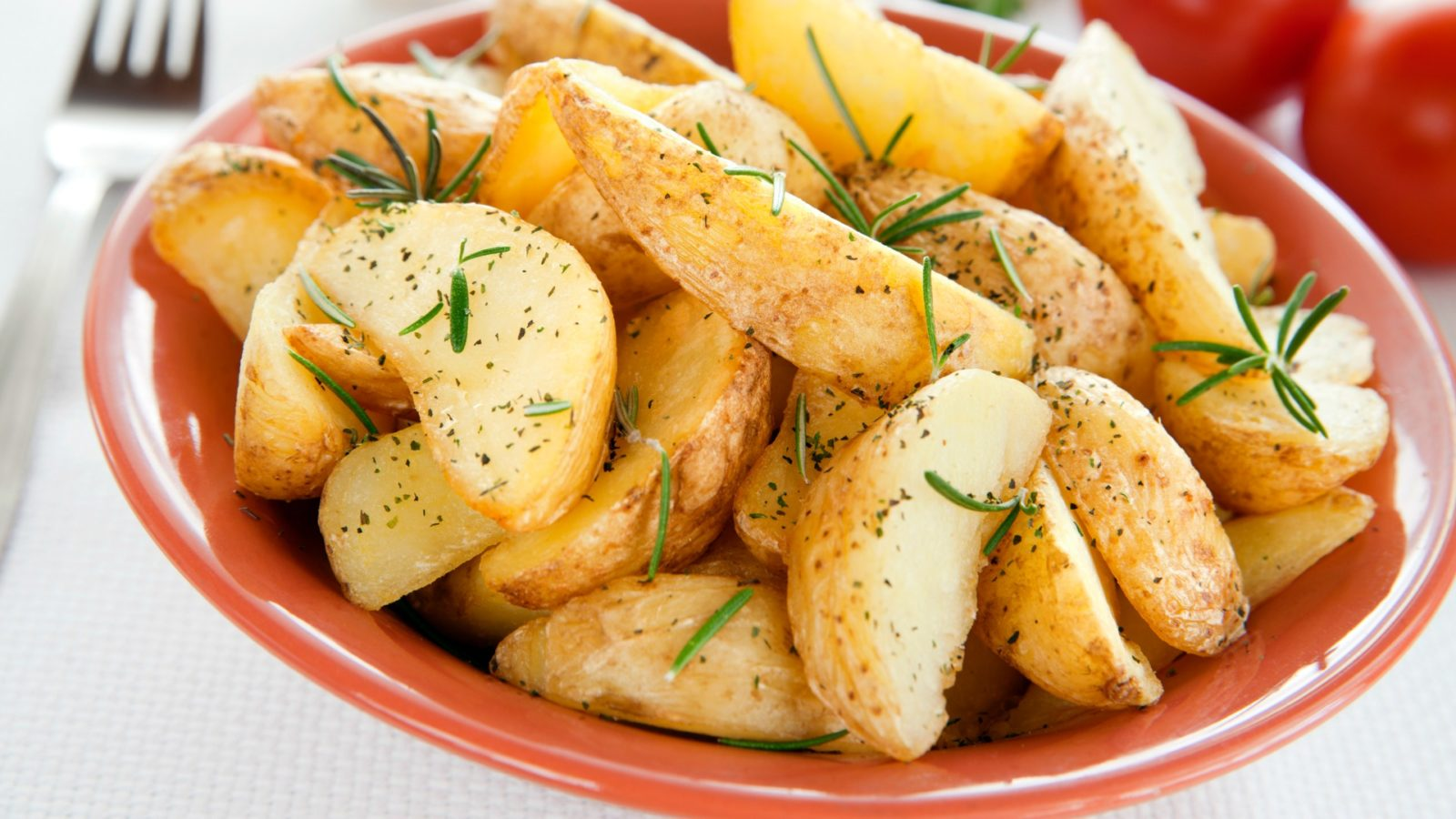 Roasted potatoes with rosemary in a bowl