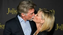 Olivia Newton-John shared a passionate kiss with her husband John  as she prepares to auction her Grease outfits. Source: Getty.