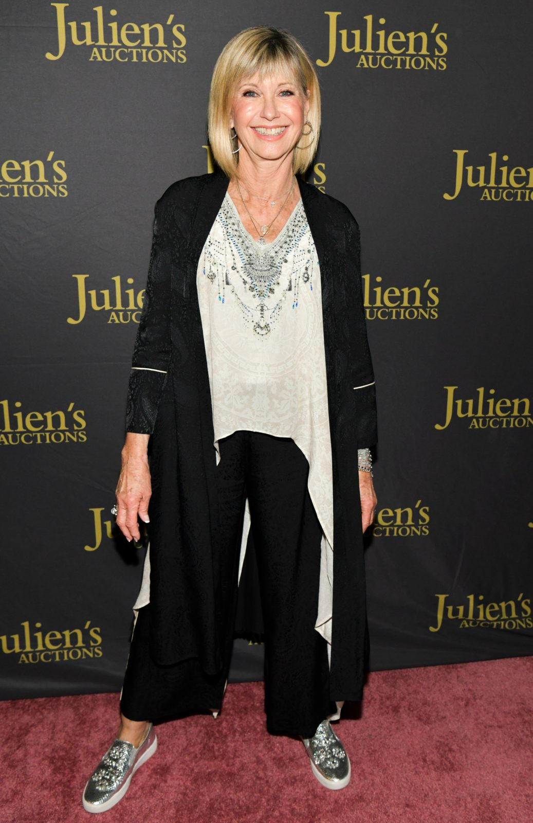 Olivia Newton-John opted for elegant comfort for the reception. Source: Getty.