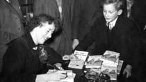 Enid Blyton signing copies of her books in 1949. This community writer was a real fan of her stories. Source: Getty Images