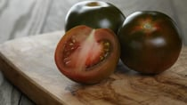 The Kumato is a natural mix of wild and traditional tomato varieties. Source: Getty