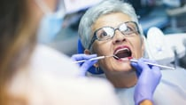 One Starts at 60 reader is concerned about getting a root canal procedure. Source: Getty