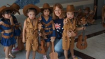 Sue with some of the children in her kindergarten class in China. Source: Sue Hannant