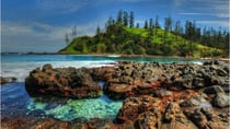 You could see the beautiful Cresswell Bay in Norfolk Island on one of your two free nights of accommodation! Source: Getty