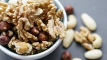 Nuts could actually help you shed some kilos. Source: Getty.