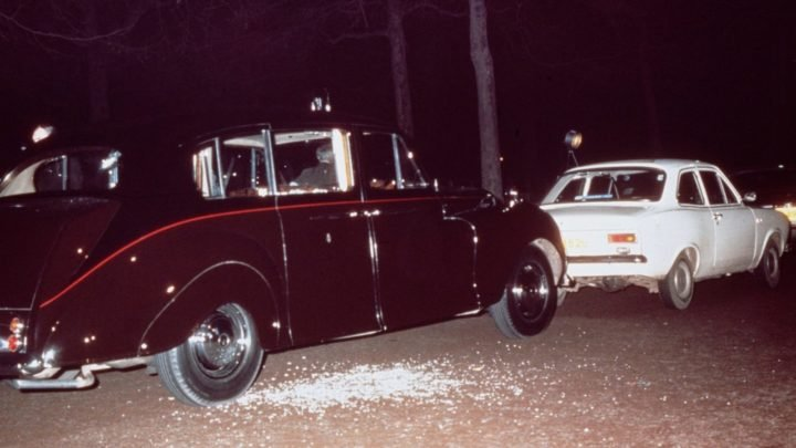 The aftermath of Ian Ball's attempted kidnapping of Princess Anne in March, 1974. Ball used the white Ford Escort to block the path of the princess's Rolls Royce limousine. Source: Hulton Archive/Getty Images