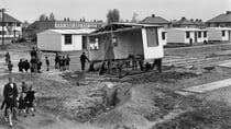 Hundreds of thousands of prefab houses were erected in estates across the UK following World War II, providing housing to those left homeless from bombing raids. Source: Getty Images