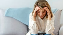 Women can experience an array of symptoms during and after menopause including headaches. Source: Getty.
