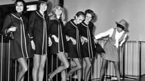 English fashion designer Mary Quant with a group of models at Heathrow Airport in 1968. Source: Getty