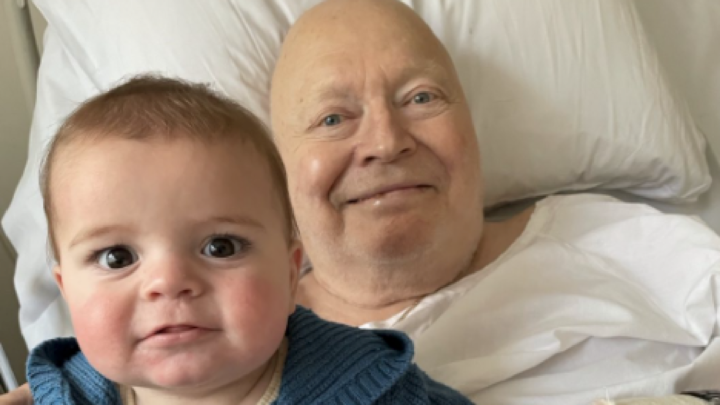 Bert Newtown poses with his grandson from his hospital bed. Source: Patti Newton/Instagram
