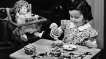 A young girl having a tea party with her doll in the 1950s. Source: Getty Images