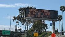Highway digital signs display messages about stay home and avoiding travel during an outbreak of the COVID-19 coronavirus, Los Angeles, California, March 25, 2020.