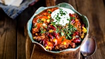 Chilli con carne with kidney beans and corn, sour cream, parsley, tortilla bread. Yum! Source: Getty Images